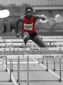 athlete over hurdles